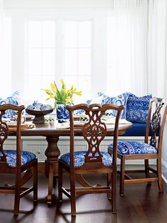 The Chippendale chairs & the lovely fabrics on the window seat make this such an inviting dining area.