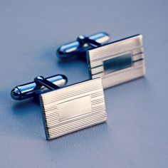 A Pair of Rectangular Sterling Silver Cuff Links with Engraved Pinstripe Detail from J. Schrecker Jewelry. Visit us at our website or at www.facebook.com/jschreckerjewelry
