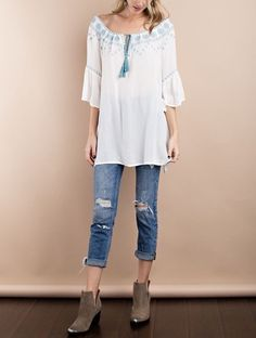 THIS WHITE AND BLUE SEA BREEZE TOP HAS A LIGHT AND SOFT WOVEN RAYON CREPON BELL SLEEVE. EMBROIDERY DETAILING OFF SHOULDER LOOSE FIT TUNIC THAT IS PERFECT FOR SPRING AND SUMMER.