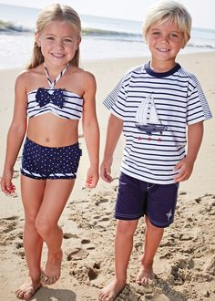 Matching swimsuits for 4th of July family photo.