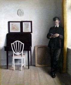 Interior with Young Man Reading(1898) byVilhelm Hammershøi