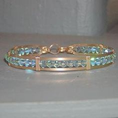 Items similar to Crystal Bead Bracelet - Glittery Aqua Swarovski Crystal Wirewrapped Bracelet - Aqua Blue - Gold Wire Bracelet - Valentines Gift on Etsy - Glittery Aqua Swarovski Crystal Wire-Wrapped by wiregems - Wire Jewelry Designs, Metal Jewelry, Beaded Jewelry, Jewelry Bracelets, Jewlery, Bracelet Fil, Wire Wrapped Bracelet, Bijoux Fil Aluminium, Crystal Beads
