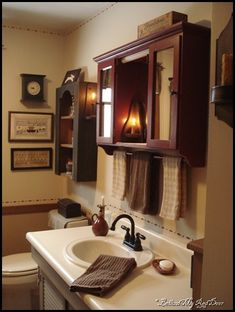Behind My Red Door: Kitchen, bathroom and life changes…love the medicine cabinet w/towel bar Country Bathrooms, Country Baths, Primitive Bathrooms, Primitive Kitchen, Primitive Homes, Outhouse Bathroom, Laundry Room Bathroom, Bathroom Renos, Bathroom Renovations