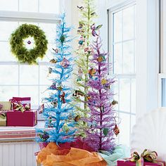 Abandon Traditional Colors  Dramatic green, pink, and blue trees embellished with whimsical sea creatures prove a welcome departure from red and green. Bright green feather wreaths and gaily wrapped packages scattered about the room continue the unconventional theme.
