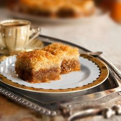 Kadaifi recipe. Kadaifi, a simplified Family recipe for a Greek dessert, filled with nuts and sugar syrup flavored with cinnamon and lemon. #sweets #traditional  - Foodista.com