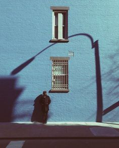 // blue wall // shadows // alone in the city