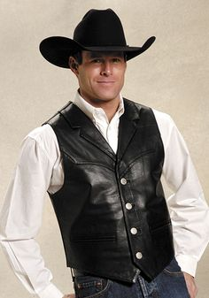 For authentic, classic, western apparel at an affordable price, Roper is the brand to trust. This classic western style mens leather vest features a notched collar and front and back yokes. This high quality outerwear item is both durable and stylish. Cowboy Outfits, Western Outfits, Western Dresses, Western Vest, Western Style, Revival Clothing, Black Cow, Groom Wear, Leather Vest