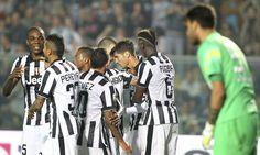 Alvaro Morata (2nd R) of Juventus FC celebrates with his team-mates after scoring his goal during the Serie A match between Atalanta BC v Juventus FC at Stadio Atleti Azzurri d'Italia on September 27, 2014 in Bergamo, Italy.