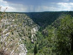 Walnut Canyon National Monument is a United States National Monument located about 10 miles southeast of downtown Flagstaff, Arizona. The canyon rim elevation is 6,690 ft., the canyon's floor is 350 ft lower. A 0.9 mi long loop trail descends 185 ft into the canyon passing 25 cliff dwelling rooms constructed by the Sinagua, a pre-Columbian cultural group that lived in Walnut Canyon from about 1100 to 1250 CE.