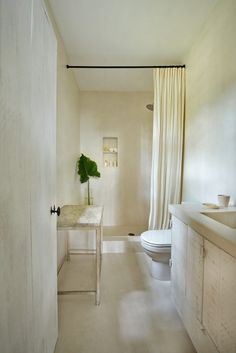 White Minimalist Bathroom in Miami Beach House
