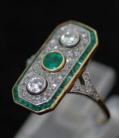 Platinum-Gold-Diamond-Emerald 1920's Art Deco ring, circa 1920.