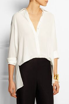 Ivory crepe Partially concealed button fastenings through front 100% viscose Dry clean Designer color: Porcelain