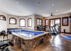 home gym with indoor Infiniti pool