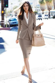 Neutral colored suit.  I do not believe in trouser suits.  Skirts suits are far more tasteful
