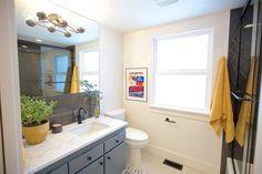 Boise Boys | Timber And Love | Luke Caldwell | HGTV | Realty | Mid Century modern | home renovation | Design | Boise Idaho | marble countertops | gray cabinets | bathroom | black tile | backsplash | modern | color pop decor | yellow bathroom