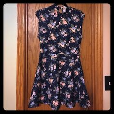 Forever 21 floral skater dress Forever 21 floral skater dress.  Gently used.  No rips, stains, or fading.  Keyhole back closure at neck with two buttons.  Scuba-style material. Forever 21 Dresses Midi
