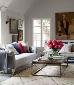 The homeowner of this California home painted the wooden Moroccan settee with basic gray primer and found the Berber rug in Marrakech. The large oil portrait is by contemporary Scottish painter Peter White, and the oak-and-steel coffee table hails from H.D. Buttercup. The swap-meet Chesterfield sofa was a flea market find reupholstered with Ikea linen.   - CountryLiving.com