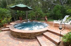 Pool Construction and Remodeling Gallery | Spool: Pool and Spa: The world's largest Spool with Majestic Isle Finish, stacked stone, Trimrod paver rock water fall. 14 feet across. Bryan Clift  (904)237-7138 Bryan@cliftandco.com