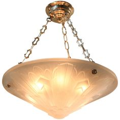 1930s Art Deco Chandelier | From a unique collection of antique and modern chandeliers and pendants  at https://www.1stdibs.com/furniture/lighting/chandeliers-pendant-lights/