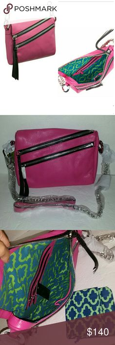 "orYANY Skyler Italian Leather Crossbody Brand new with tag. Comes with dust  bag. Color magenta . Style: Skyler Removable crossbody strap with chain detail, zip-top closure, zip pocket, slip pocket with magnetic snap closure for iPad mini Lined interior, two back-wall zip pockets, front-wall slip pocket Measures approximately 11""W x 8""H x 1-1/2""D with a 24"" strap drop; weighs approximately 1 lb, 6 oz Body/trim 100% leather; lining 100% cotton; pocket lining man-made materials orYany skyler…"
