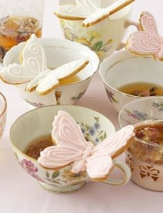 high tea --love the butterfly cookies perched on teacups!