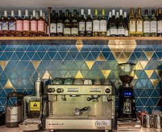 Handcrafted splashback tiles with vibrant gold and bold blue behind a London bar to catch the eye of customers. This splashback was designed for a project and is featured in our new quarter magazine. Splashback Tiles, River Park, Bulletins, Vibrant, Magazine, London, Bar, Gold, House