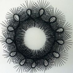 Andi Regan, based in Central Otago. Lives in Wanaka. I saw several of her sea urchin zip tie scultures at the Halabulu Art Gallery in Old Cromwell. She has a degree in textiles! I love her inventive use of zip ties! She dies them as well