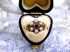 Items similar to Georgian Mourning Ring Ruby Pearl Hair Locket Gold on Etsy Mourning Ring, Antique Jewelry, Vintage Jewelry, Pearl Hair, Georgian, My Etsy Shop, Geek Stuff, Brooch