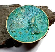 Turquoise Mint Dragonfly Ring Dish- Handmade Jewelry Holder-Trinket Dish- Polymer Clay Dish- Home Decor- Gifts for Home- Candle Holder. Handmade Jewelry Dish/ Wedding Ring Holder Dragonfly dish is done in a soft Turquoise Mint *please allow 3-5 days production time for this special dish! Polymer clay dish is hand-painted 18K Gold Leaf edge & accents.The Dragonfly is also made from clay, it is attached and raised on the dish. Photo #3 shows the bottom of the dish with coordinating pattern…