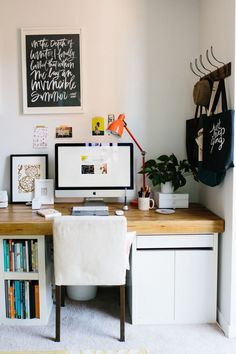 Chic home office space with ikea shelves and diy wooden surface | Jen Serafini's Chicago Apartment Tour | The Everygirl