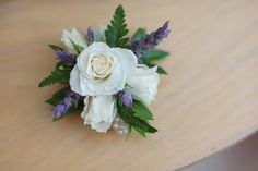 The family members will wear corsages of ivory spray roses accented b y fresh lavender and rosemary on a silver beaded bracelet.