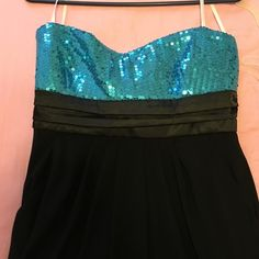 Blue and Black Strapless Dress Blue sequins at top of dress. Satin tie that can be tied in the back. Flowy black bottom. Also has pockets!! Only worn once as shown in last picture. Size XL but also fits a Large. Deb Dresses Strapless