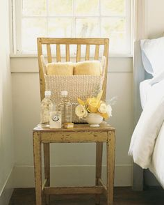 Beautiful idea for a guest room - a basket filled with all the necessities. Towels, toiletries, bottled water, chocolates, and of course, fresh flowers.