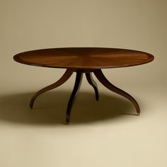 """Rose Tarlow Melrose House Table in Mahogany, top in sunburst pattern with 3"""" banding, legs with sabots, in medium mahogany stain. Available in Walnut with dark walnut stain for no upcharge. Shown in 72"""" Diameter"""