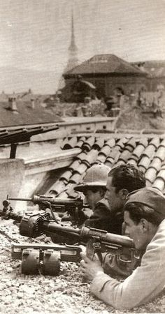 "Italian antifascist freedom fighters in Turin. WW 2. They seem to be armed with ""grease guns"""
