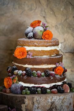 Naked Wedding Cake with Figs, Berries and Frosted Grapes