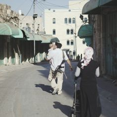 A Jewish settler on the deserted street. in Hebron. It used to be a main market street, but it is deserted because Palestinians are no longer allowed there. West Bank 2010.