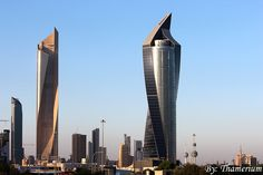 Left: Al Hamra Tower, Architect: SOM / Al Jazera Consult 2005 ------- Right: Al Tijaria Tower // Architect: Norr Group / Al Jazera Consult, 2009 Location: Kuwait City , Kuwait Places Around The World, Around The Worlds, Engineering Firms, Building Images, Photo Dump, The Future Is Now, Photographs Of People, Skyscrapers, Middle East