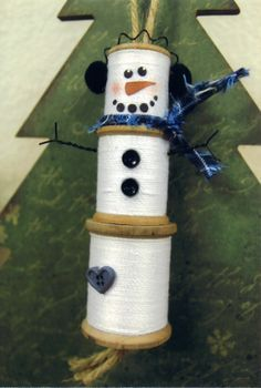 Crafty crafts just crafted this cool spool! Made with three wooden spools. Wrapped with crochet thread.