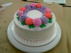 Wilton course 1 final cake.  Yellow cake with strawberry filling and buttercream icing.