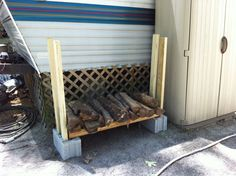 Homemade fire wood storage. 2 - cinder blocks, 2 - 4 ft landscaping timbers and 4 - 4 ft. 2x4. Couldn't be easier or cheaper.