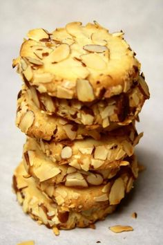 Cream Cheese Almond Cookies ... no recipe, but i can figure this out.      2 cups all-purpose flour      1/2 teaspoons salt      2 sticks unsalted butter, soften      3 ounces cream cheese, room temperature      1/2 cup sugar      1 tablespoon vanilla extract      1 egg white      1 cup almond slices, lightly toasted