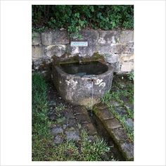 Old stone trough fountain with rill