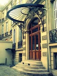 half circle glass awning over doorway in france