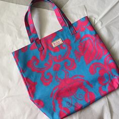 Lilly Pulitzer Tote! Lilly Pulitzer for Estee Lauder! Excellent condition!! Blue with pink sea creatures!!! 14x16 inches!! Great size! Lilly Pulitzer Bags Totes