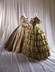 Dress on left, ca. 1858, French, silk. Crocheted and beaded trim.