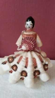 Beautiful vintage lady made with sea shells