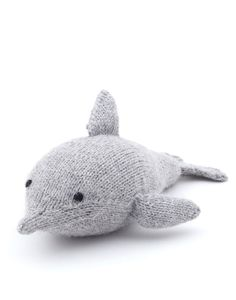 """- Description - Artisan - Hang Tag This tropical dolphin is the perfect toy for the warmer weather. * Approximately 9"""" tall; alpaca with polyester fill * As with all handwoven items, variations will o"""