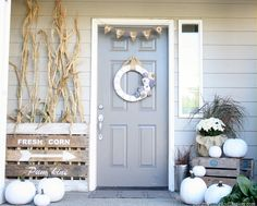 Neutral Fall Porch by Design, Dining + Diapers, neutral fall decor, white pumpkins, corn stalks, Vintage Farm house signs, gray door, fabric wreath, burlap bunting