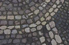 Detail; stone mosaic; historic district; Ljubljana, Slovenia.  January 2015.